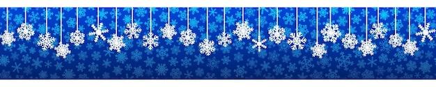 Banner di natale senza soluzione di continuità con fiocchi di neve appesi bianchi con ombre su sfondo blu