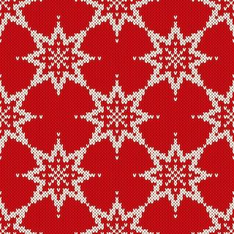 Reticolo lavorato a maglia senza giunte di natale con i fiocchi di neve. sfondo di natale e capodanno.