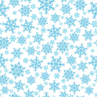 Modello senza cuciture di natale di fiocchi di neve grandi e piccoli, blu su bianco blue