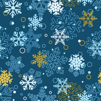 Modello senza cuciture di natale di fiocchi di neve grandi e piccoli, multicolori su blu