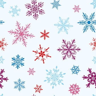 Modello senza cuciture di natale di fiocchi di neve multicolori grandi e piccoli complessi su fondo bianco