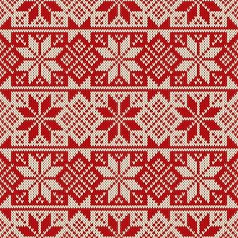 Ornamento di natale senza cuciture sulla trama lavorata a maglia di lana.