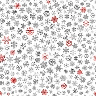 Reticolo senza giunte di natale di piccoli fiocchi di neve, rosso e grigio su bianco