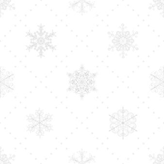 Reticolo senza giunte di natale di fiocchi di neve e punti, grigio su bianco