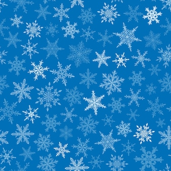 Reticolo senza giunte di natale dei fiocchi di neve, bianco su sfondo blu.