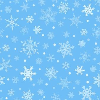 Reticolo senza giunte di natale dei fiocchi di neve, bianco su sfondo azzurro.