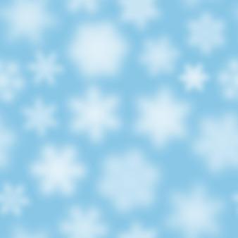 Reticolo senza giunte di natale di fiocchi di neve sfocati bianchi su sfondo azzurro