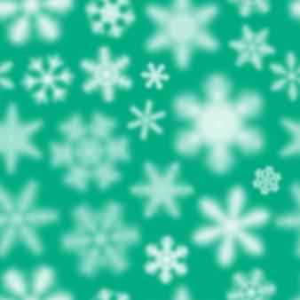 Reticolo senza giunte di natale di fiocchi di neve sfocati bianchi su sfondo turchese