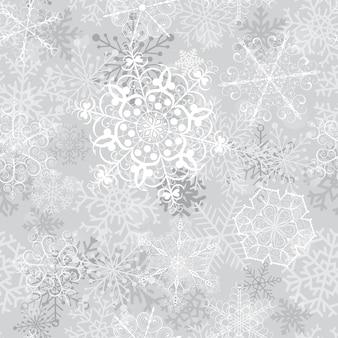 Reticolo senza giunte di natale con grandi fiocchi di neve su sfondo grigio