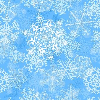 Reticolo senza giunte di natale con grandi fiocchi di neve su sfondo azzurro