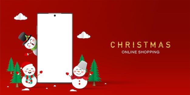 Shopping natalizio online sul concetto di smartphone, smartphone con schermo vuoto con pupazzo di neve, buon natale