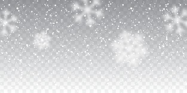 Neve di natale. fiocchi di neve che cadono su sfondo trasparente. nevicata.