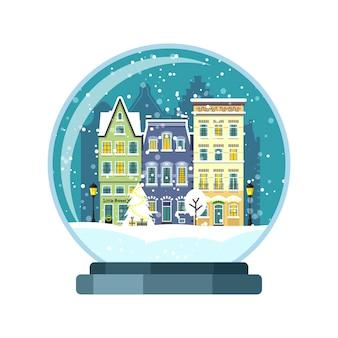 Globo di neve di natale con case di amsterdam. illusione isolata