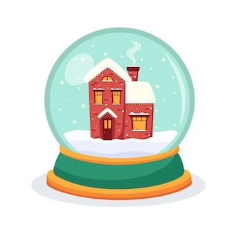 Globo di neve di natale con una casa all'interno