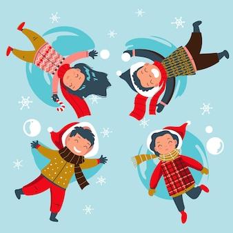 Scena di neve di natale con i bambini che si divertono