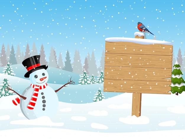 Pupazzo di neve di natale con cartello in legno e alberi di pino