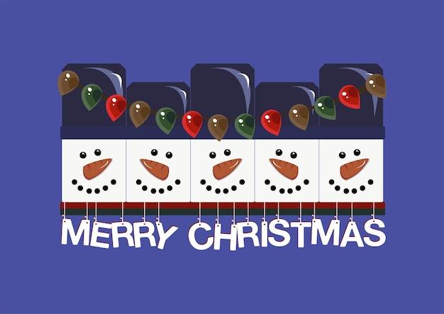 Pupazzi di neve di natale in cappelli e naso di carota con un gerland e la scritta merry christmas