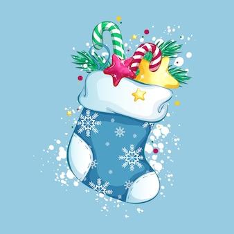 Calzino di natale con bastoncini di zucchero, stella d'oro, ramo di un albero e altri regali. decorazioni natalizie tradizionali.