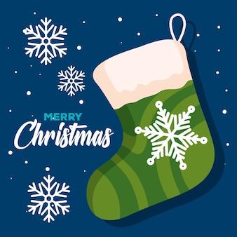 Calza di natale con fiocchi di neve, banner di capodanno e buon natale celebrazione design