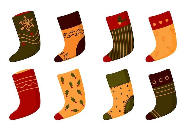 Set di calzini natalizi. stivale di babbo natale con fiocco di neve, bacche.
