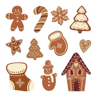 Collezione di dolci natalizi con pan di zenzero decorativo isolato
