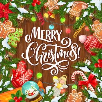 Albero di natale, regali di natale e rami di pino e albero di agrifoglio cornice su fondo in legno. regali per le vacanze invernali, bastoncini di zucchero e neve, pan di zenzero, angelo con stella, luci e fiocchi di neve
