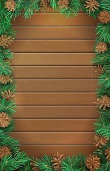 Fondo di legno verticale di natale con rami di pino e coni