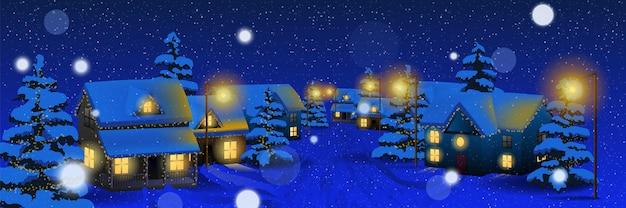 Villaggio di natale di notte. villaggio di natale invernale e neve.