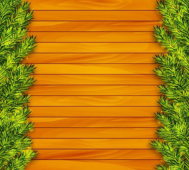 Fondo di legno di natale con rami di abete