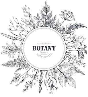 Cornice circolare con elementi di erbe e fiori selvatici disegnati a mano in bianco e nero per inviti di nozze, biglietti di auguri.