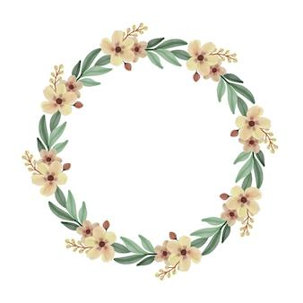Cornice circolare con fiori gialli e bordo di foglie verdi