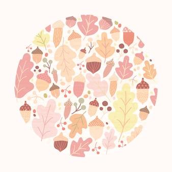 Composizione circolare in autunno con le foglie, le ghiande e le bacche cadute della quercia isolate.