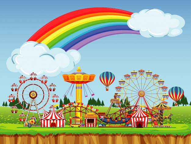 Scena del circo con l'arcobaleno nel cielo