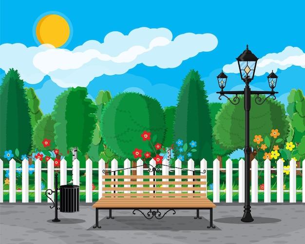 Concetto di parco cittadino, panca in legno, lampione, pattumiera in piazza e alberi.