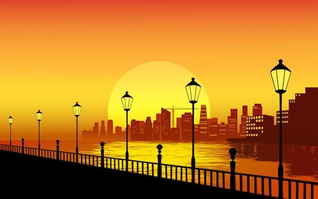 Paesaggio tramonto della città con lampioni