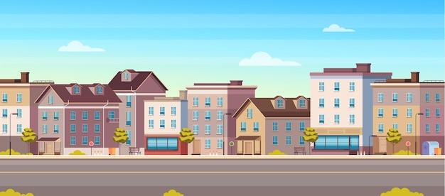 Concetto orizzontale delle costruzioni della via della casa di città della città