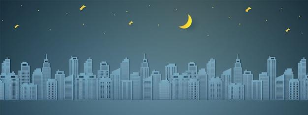 Paesaggio urbano di notte, edificio con mezza luna e stella, stile arte della carta