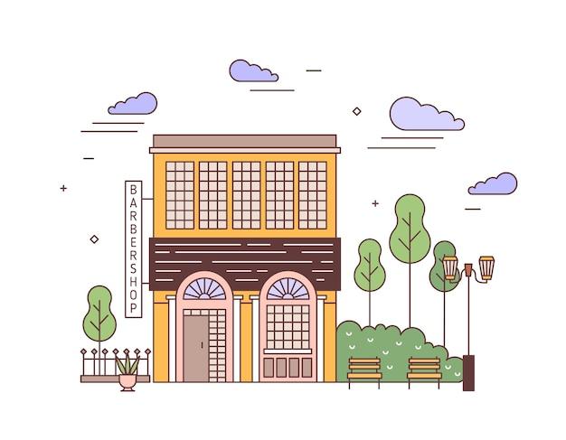 Paesaggio urbano con facciata di un elegante edificio a due piani di architettura europea con insegna da barbiere