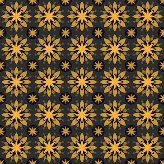 Fondo senza cuciture classico batik. carta da parati mandala geometrica di lusso. elegante motivo floreale tradizionale in colore oro giallo