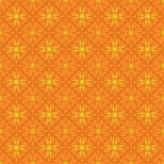 Fondo senza cuciture classico batik. carta da parati geometrica di lusso. elegante motivo floreale tradizionale di colore arancione