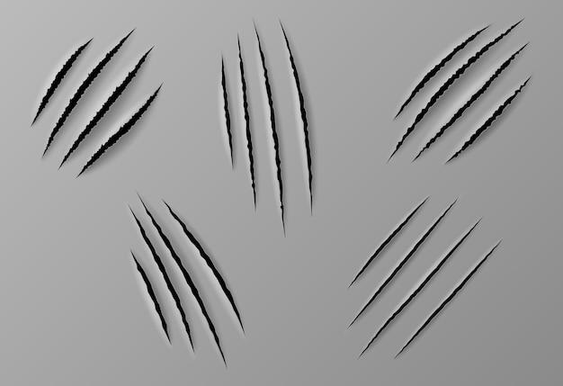 Graffi di artigli isolati. le unghie degli animali selvatici si strappano, le zampe di tigre, di orso o di gatto si strappano su sfondo grigio
