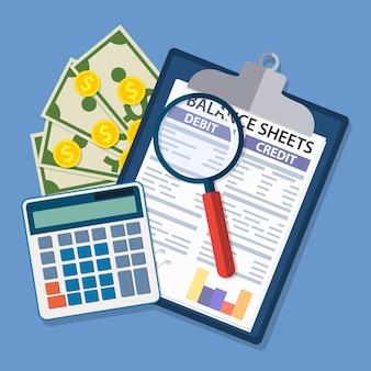 Appunti con bilancio e lente di ingrandimento