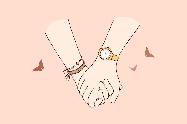 Primo piano delle mani delle coppie che si tengono durante la passeggiata