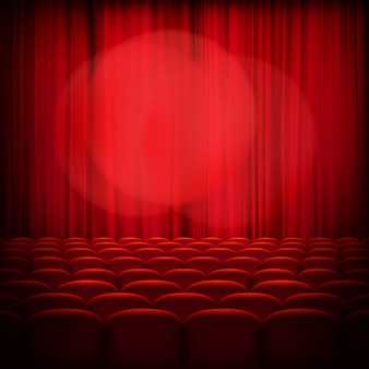 Tende rosse del teatro chiuso con riflettori e sedili.