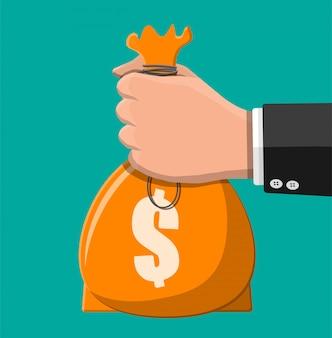 Borsa di stoffa con soldi in mano