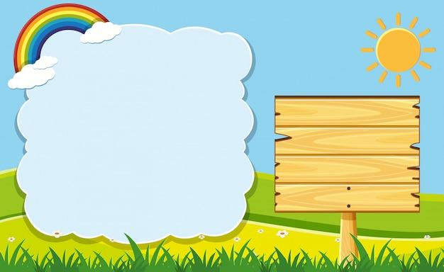 Cornice di nuvole e tavola di legno in giardino