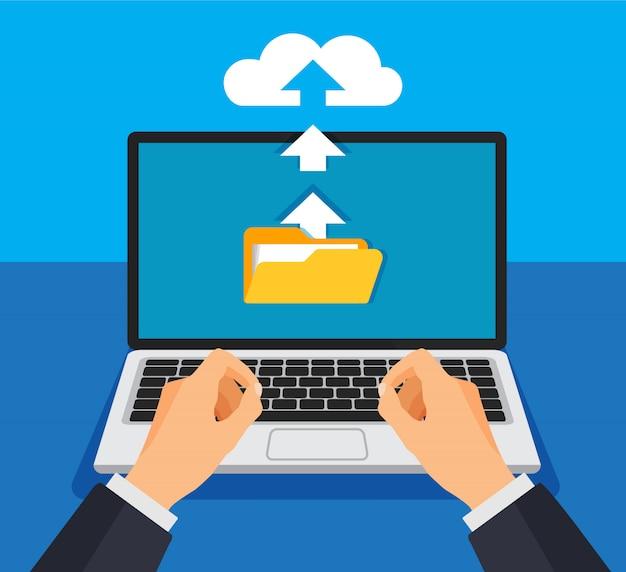 Concetto di archiviazione cloud. l'uomo d'affari carica i file nell'archiviazione cloud sul computer portatile.