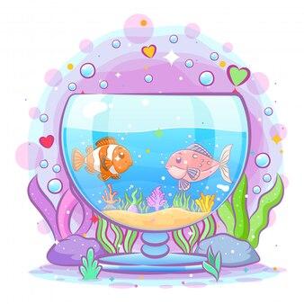 Il pesce pagliaccio gioca con i suoi amici all'interno dell'acquario