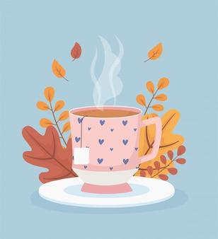 Tempo e tè del caffè, bustina di tè della tazza sulla stagione delle foglie del piatto