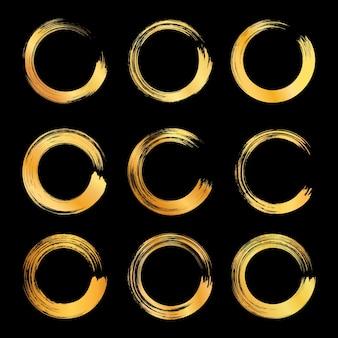 Raccolta di cornice circolare astratta del tratto di pennello dorato.